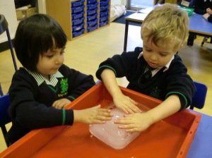 Zachary and Aisha discovering that ice is really cold and very slippery!