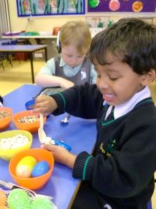 Jacob making his Egg Shaker.