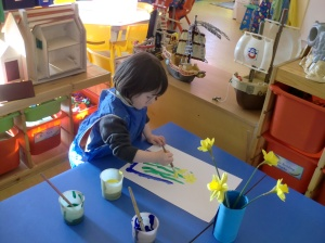 Eleanor painting daffodils
