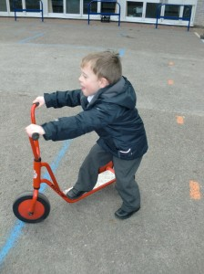 We love to ride our bikes and scooters in the big playground!
